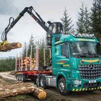 Owner Driver Yule Logs In With Rugged Arocs